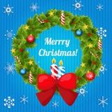 Венок рождества украшенный с шариками, звездами и Стоковое Изображение