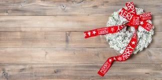 венок тесемки рождества красный Праздничный орнамент Стоковые Изображения