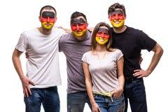 Вентиляторы сторонников группы людей национальных команд Германии с покрашенными эмоциями улыбки стороны флага счастливыми Дует э стоковые фотографии rf