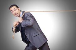 веревочка бизнесмена вытягивая Стоковое Изображение