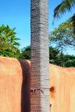 Веревочка корд крупного плана и оранжевая стена стоковые изображения