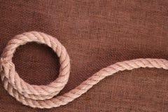 Веревочка на мешковине Стоковая Фотография