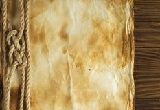 Веревочка на старой бумажной предпосылке Стоковая Фотография RF