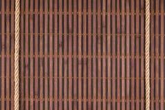 2 веревочки лежа на бамбуковой циновке Стоковое Фото