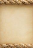 Веревочки на старой предпосылке бумаги сбора винограда Стоковая Фотография