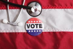 Вереск США голосуя Pin на флаге Стоковое фото RF