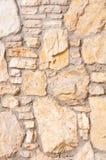 Вертикальная каменная стена предпосылки каменной кладки Стоковые Изображения