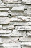 Вертикальный свет - серая каменная стена Стоковые Изображения RF