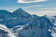 Верхние части горы покрытые с снегом Стоковое Фото