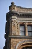 Верхний угол кирпичного здания Стоковое Фото