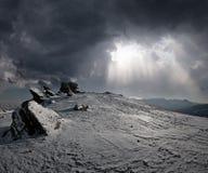 Верхняя часть горы на заходе солнца Стоковая Фотография RF