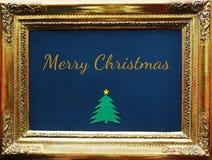 Веселое рождество, написанное в античной золотой картинной рамке стоковое изображение