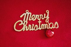 Веселое рождество на красной предпосылке стоковая фотография