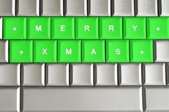 Веселый Xmas сказанный по буквам на металлической клавиатуре Стоковое Изображение RF