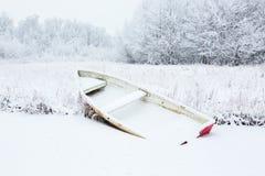 Весельная лодка на зиме стоковое фото rf