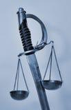 Весы правосудия шпаги стоковое фото