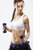 Весы привлекательной женщины поднимаясь Стоковая Фотография RF
