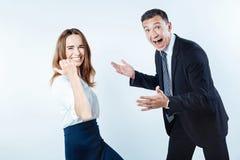 Весьма счастливые бизнесмены празднуя успешный проект Стоковые Изображения