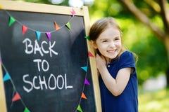 Весьма excited маленькая школьница Стоковая Фотография