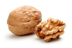 Весь грецкий орех и половинная часть грецкого ореха Стоковые Фотографии RF