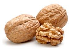 Весь грецкий орех и половинная часть грецкого ореха Стоковые Фото