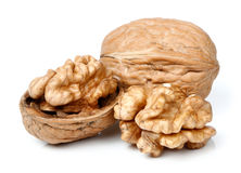 Весь грецкий орех и половинная часть грецкого ореха Стоковые Изображения