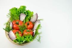 Весь томат и прерванный лук Стоковые Фото