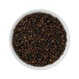 Весь черный перец в керамическом шаре Стоковое фото RF