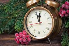 Ветви часов и ели рождества Стоковое Изображение