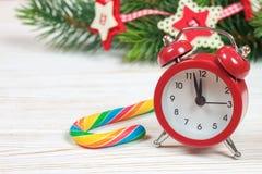 Ветви часов и ели рождества Стоковые Изображения
