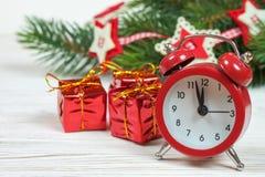 Ветви часов и ели рождества Стоковая Фотография