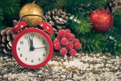 Ветви часов и ели рождества Стоковые Фото
