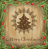 Ветви fir-tree рождества против древесины Стоковое Изображение
