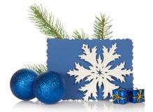 Ветвь ели, 2 игрушки рождества, снежинка Стоковое Фото