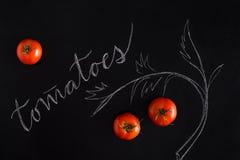 Ветвь зрелых красных томатов вишни Стоковое Фото