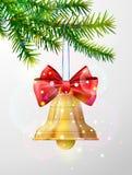 Ветвь рождественской елки с золотым колоколом звона Стоковое фото RF