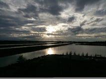 ветер захода солнца шторма абстракции стоковая фотография