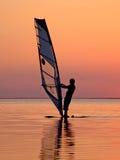 ветер серфера захода солнца 3 силуэтов Стоковые Фото
