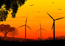 ветер турбины захода солнца Стоковое фото RF