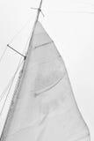Ветрило парусника против неба Стоковые Изображения