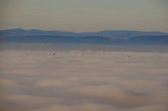 Ветротурбины в тумане Стоковое фото RF