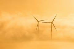 Ветротурбины в туманном sunrice Стоковое фото RF