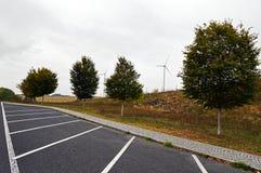 Ветротурбины между деревьями Стоковое Изображение
