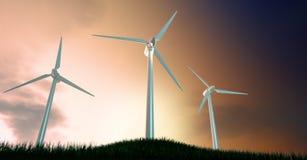 Ветротурбины на травянистом холме на зоре Стоковое Изображение
