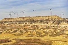 Ветротурбины на холме перед голубым небом Стоковое Фото