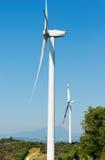 Ветротурбины на ясном голубом небе - Вероне Италии Стоковые Фотографии RF