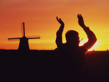 Ветрянка на заходе солнца Стоковое Изображение RF
