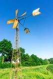 Ветрянка для водяной помпы с голубым небом Стоковое Фото