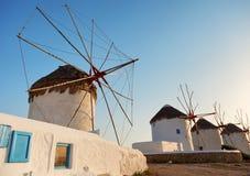 Ветрянки в Mykonos, Греции на заходе солнца Стоковое фото RF