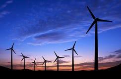 ветрянки захода солнца силуэта предпосылки Стоковое фото RF